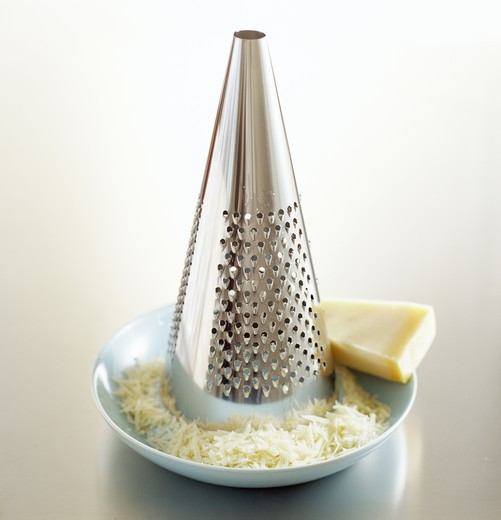 Stock Photo: 4306R-8730 A grater and parmesan cheese, close-up.