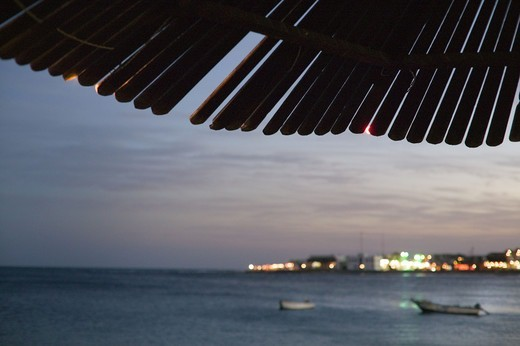 Stock Photo: 4306R-9367 Detail of a parasol with a view over the sea.