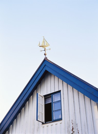 Stock Photo: 4306R-9711 A weather vane on a roof.