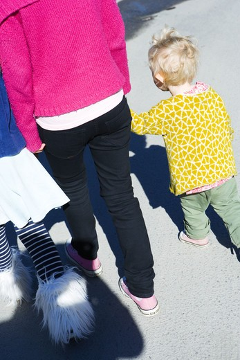 Stock Photo: 4306R-9769 Three girls holding hands.