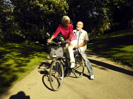 Stock Photo: 4306R-9822 A couple on a bicycle.