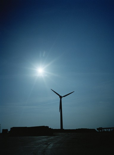 Silhouette of a wind power station. : Stock Photo