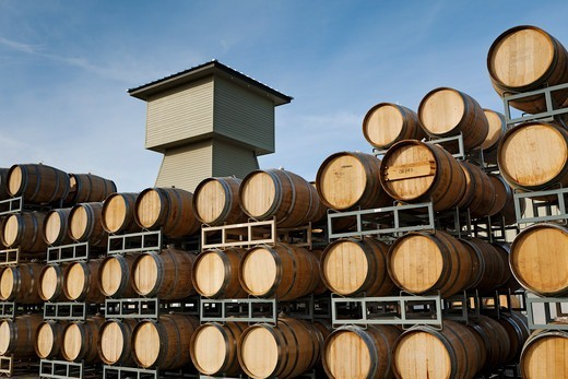 Stock Photo: 4309-218 Barrels stacked up behind a Winery in Prosser, Washington.