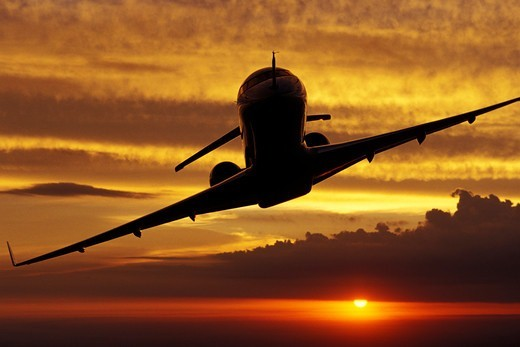 Silhouette of a State of the Art Long Range Corporate Jet at Sunset : Stock Photo