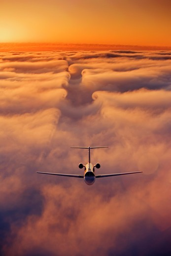 Business Jet Aerial with Vortices : Stock Photo