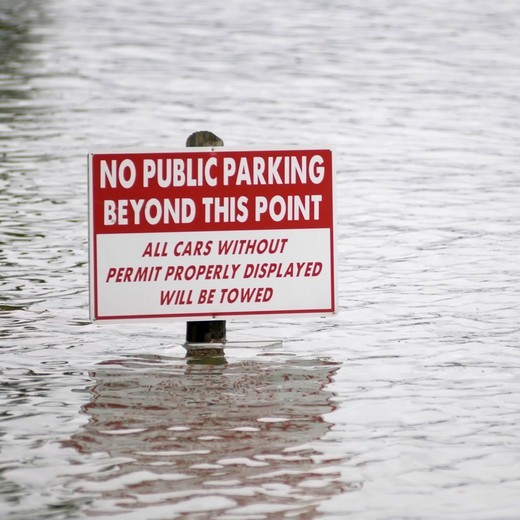 No Public Parking Sign Submerged in Flood Waters : Stock Photo