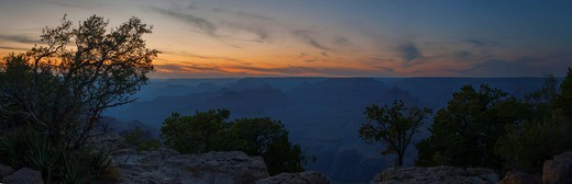 The Grand Canyon is seen after sunset bathed in twilight colors in this panorama taken from the South Rim, Arizona : Stock Photo