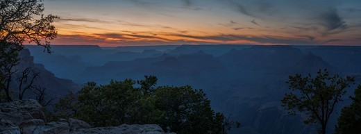 Stock Photo: 4313-1168 The Grand Canyon is seen after sunset bathed in twilight colors in this panorama taken from the South Rim, Arizona