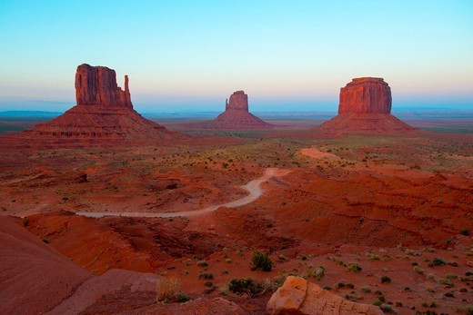 The buttes known as the Mittens (west mitten at left, east mitten at center) are seen after sunset in Monument Valley Tribal Park, on the Utah-Arizona border : Stock Photo