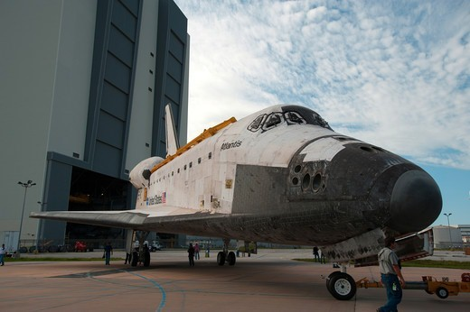 The Space Shuttle Atlantis is seen as it is moved between the Vehicle Assembly Building and Orbiter Processing Facility to undergo final preparations for its transfer to the Kennedy Space Center Visitors Complex museum following its retirement at the end of the shuttle program. : Stock Photo