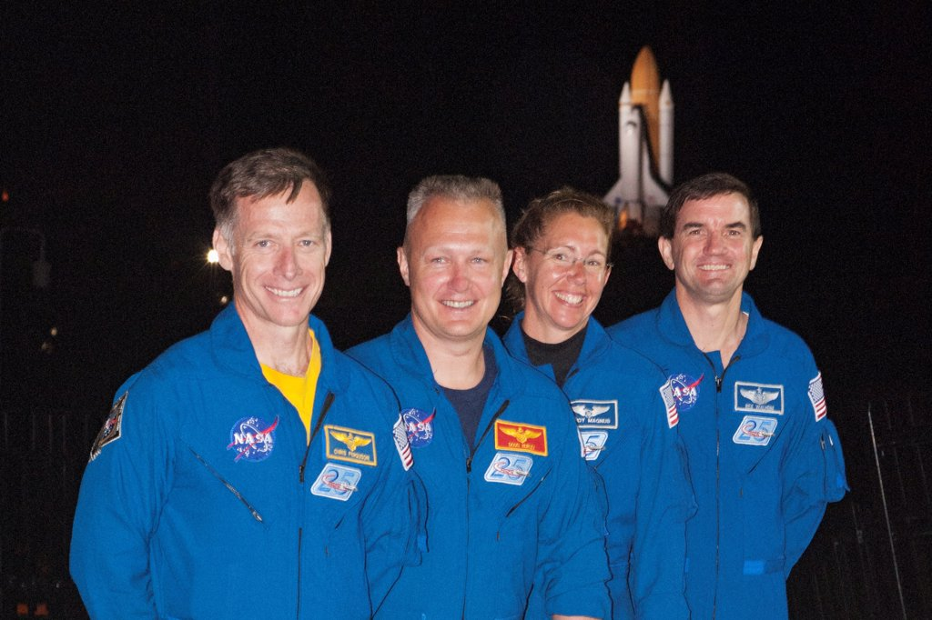 Final Shuttle Crew With Atlantis in Background : Stock Photo