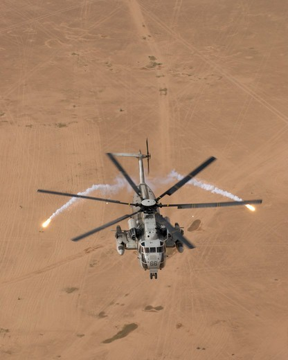 A US Marine Corps CH-53D Sea Stallion Helicopter Expends Flares to Counter Heat Seeking Anti Aircraft Missiles Over Iraq's Al Anbar Province : Stock Photo