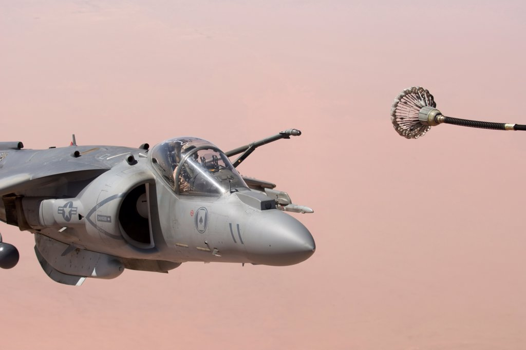 A US Marine Aviator Carefully Maneuvers His AV-8B Harrier Into Position to Refuel His Craft High Over the Al Anbar Province of Iraq : Stock Photo