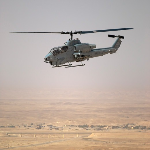 A US Marine Corps AH-1W Super Cobra During a Close Air Support Mission Above Iraq's Al Anbar Province : Stock Photo