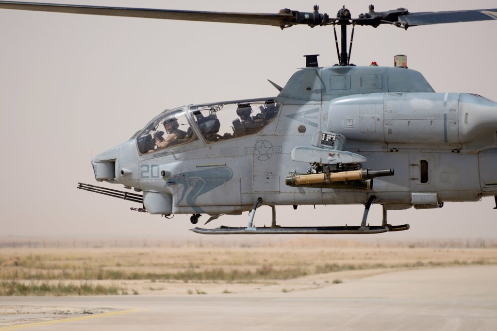 Stock Photo: 4316-1105 A US Marine Corps AH-1W Attack Helicopter Hovers After Refueling at Al Asad Air Base in the Al Anbar Province of Iraq