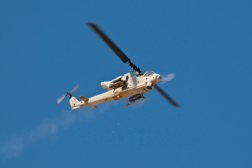 Stock Photo: 4316-1521 Marine Corps AH-1W Super Cobra Fires 20mm Gun