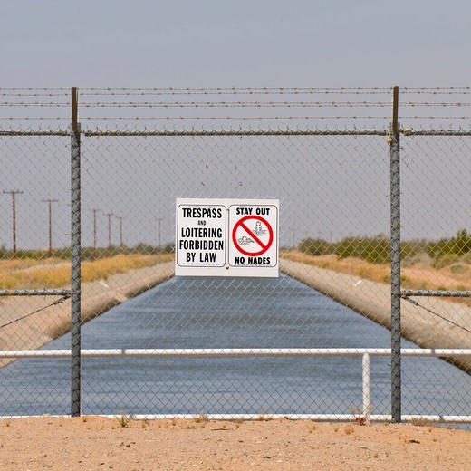 Stock Photo: 4316-1542 No Trespassing Sign Along the All-American Canal