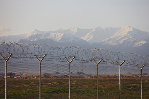 Stock Photo: 4316-1986 Razor Wire and Hindu Kush Mountains