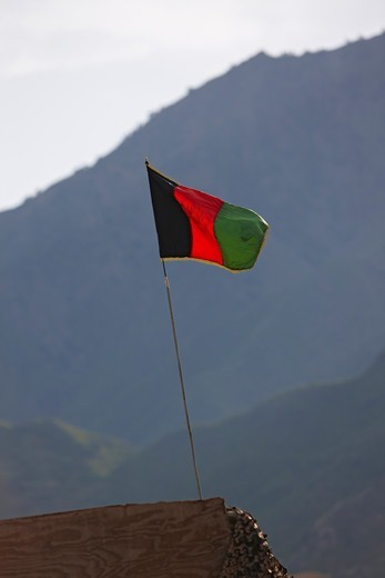 Stock Photo: 4316-2103 Flag of Afghanistan, Being Flown at a Military Base