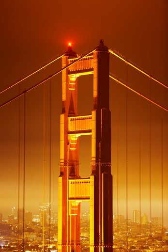 Stock Photo: 4316-2539 Pre-dawn view of the north tower of the Golden Gate Bridge, under a thick deck of fog.