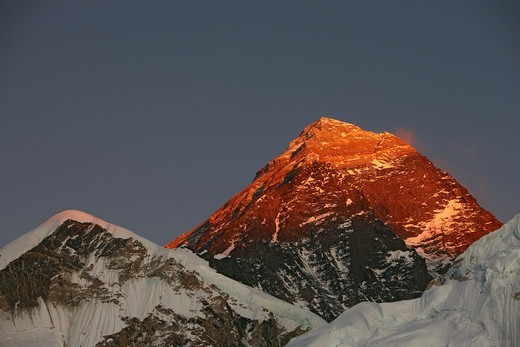 Stock Photo: 4316-2736 The last of the day's sunlight casts a brilliant orange and red alpenglow  on the summit pyramid of Mount Everest, Nepal.