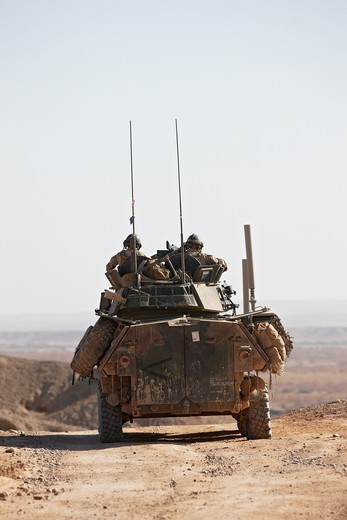 Stock Photo: 4316-2842 U.S. Marines of the 4th Light Armored Reconnaissance ride in a LAV-25, or Light Armored Vehicle, in the southern portion of Afghanistan's Helmand Province.