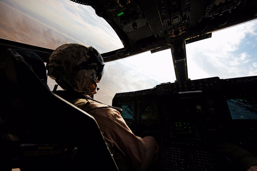 U.S. Marine Corps aviator in the cockpit of an MV-22 Osprey, Helmand Province, Afghanistan, steeply banking the Osprey. : Stock Photo