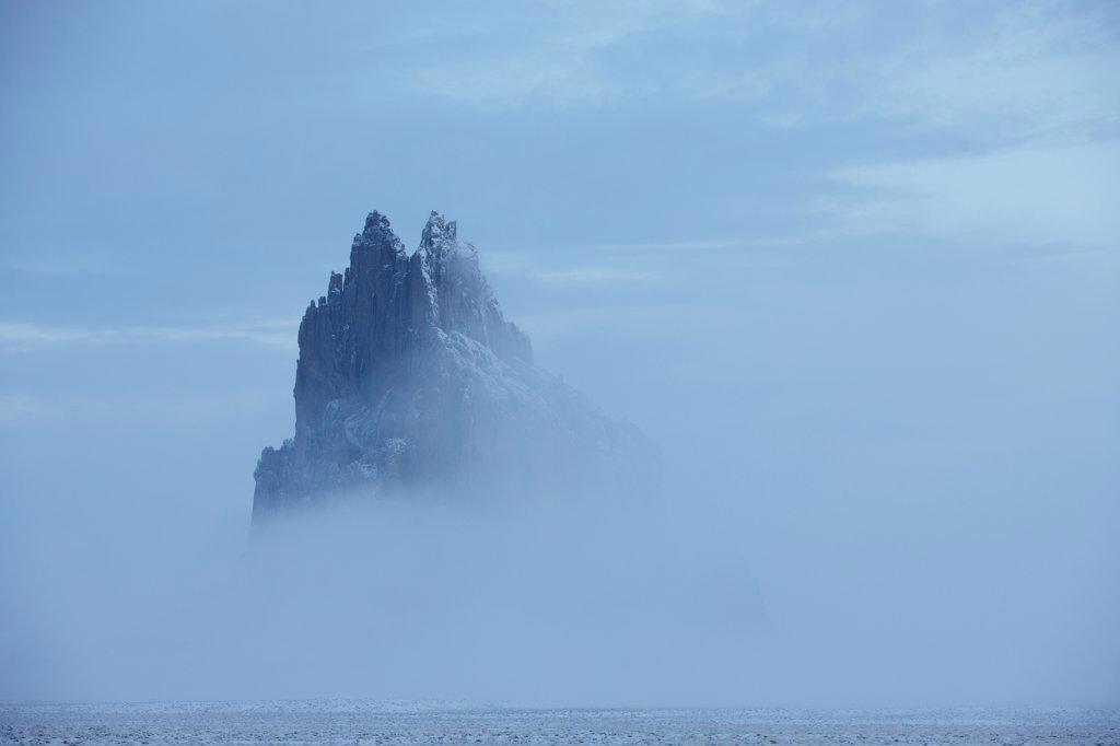 Stock Photo: 4316-3150 Winter fog shrouds Shiprock, also called Ship Rock, an ancient volcanic plug near Farmington, New Mexico.