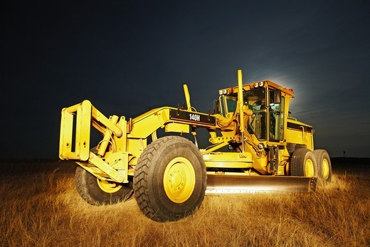 Stock Photo: 4316-3239 A night view of a grader, also known as a road grader, Weld County, Colorado, in the Pawnee National Grasslands.