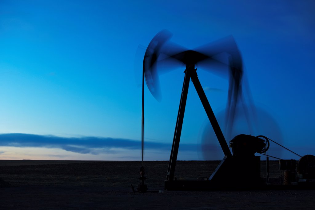 Stock Photo: 4316-3308 An oil  well pump jack in northeastern Colorado, showing motion of the pump, the end known as the 'horsehead' (left side), walking beam, crank, and counterweight. A pump jack is also known as a pumpjack, a pumping unit, a grasshopper pump, and a jack pump, among other names.