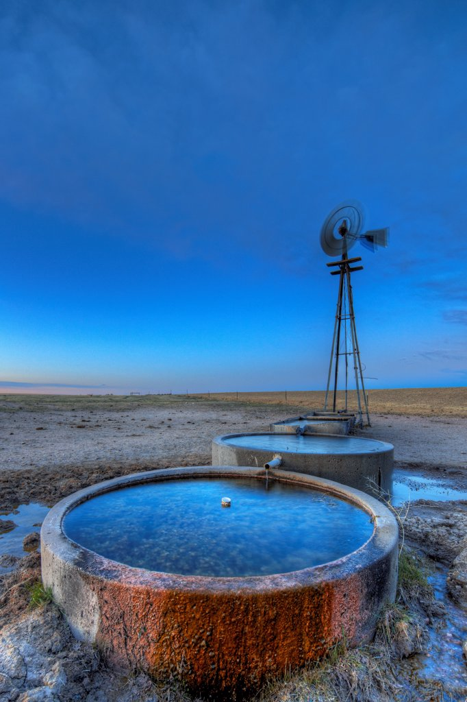 Stock Photo: 4316-3317 A high dynamic range, or HDR, image of an Aeromotor wind powered water pump, or windmill, in the Pawnee National Grasslands, Colorado.