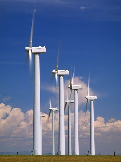 A Phalanx of Wind Turbines Transform Flowing Air Into Electricity : Stock Photo