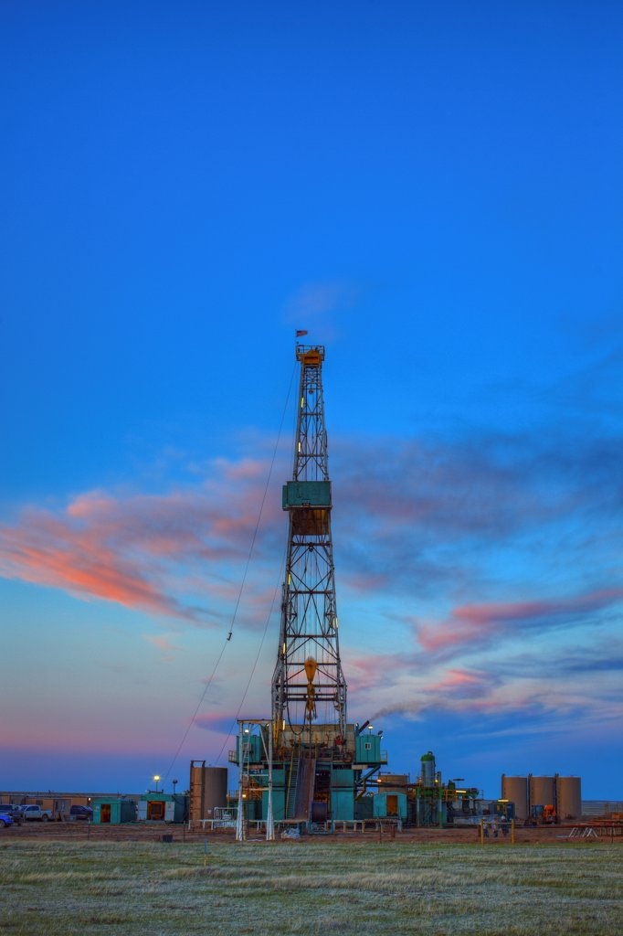 Hydraulic fracturing natural gas drilling rig at dusk, in the eastern Colorado plains. High Dynamic Range, or HDR, view. : Stock Photo