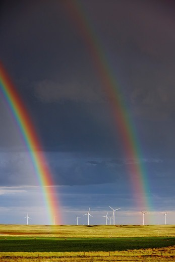Stock Photo: 4316-3474 Double rainbow seemingly emanating from wind turbines.
