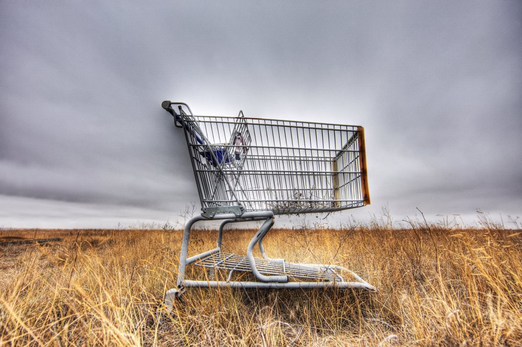 Stock Photo: 4316-3541 A shopping cart abandoned on the prairie of Colorado's eastern plains, High Dynamic Range, or HDR, Image.