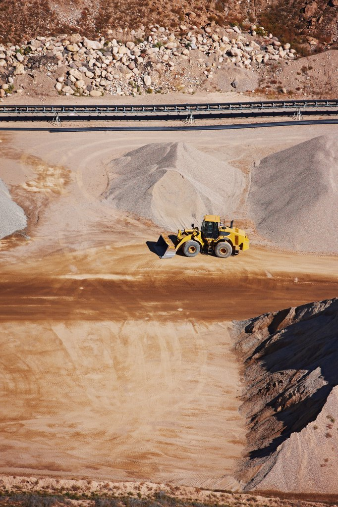 Stock Photo: 4316-3614 Aerial view of a front end loader in a gravel quarry.