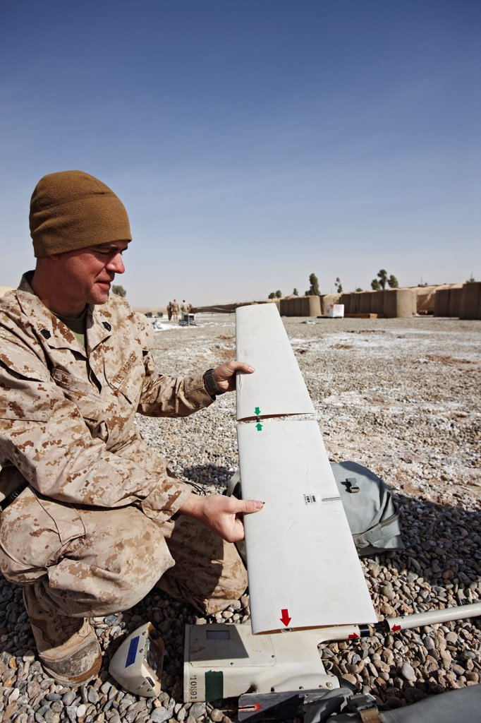A U.S. Marine Assembles an Unmanned Aerial Vehicle (UAV) in Afghanistan's Helmand Province : Stock Photo