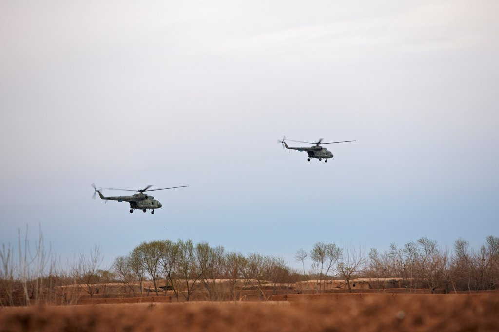 Stock Photo: 4316-3916 Afghan Special Operations Forces Helicopters During an Early Morning Raid in Afghanistan's Helmand Province