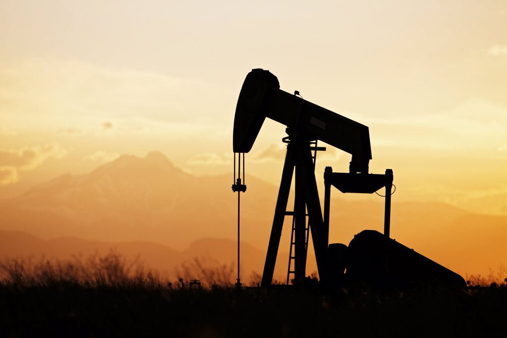 Stock Photo: 4316-4056 Oil Well Pump Jack at Sunset