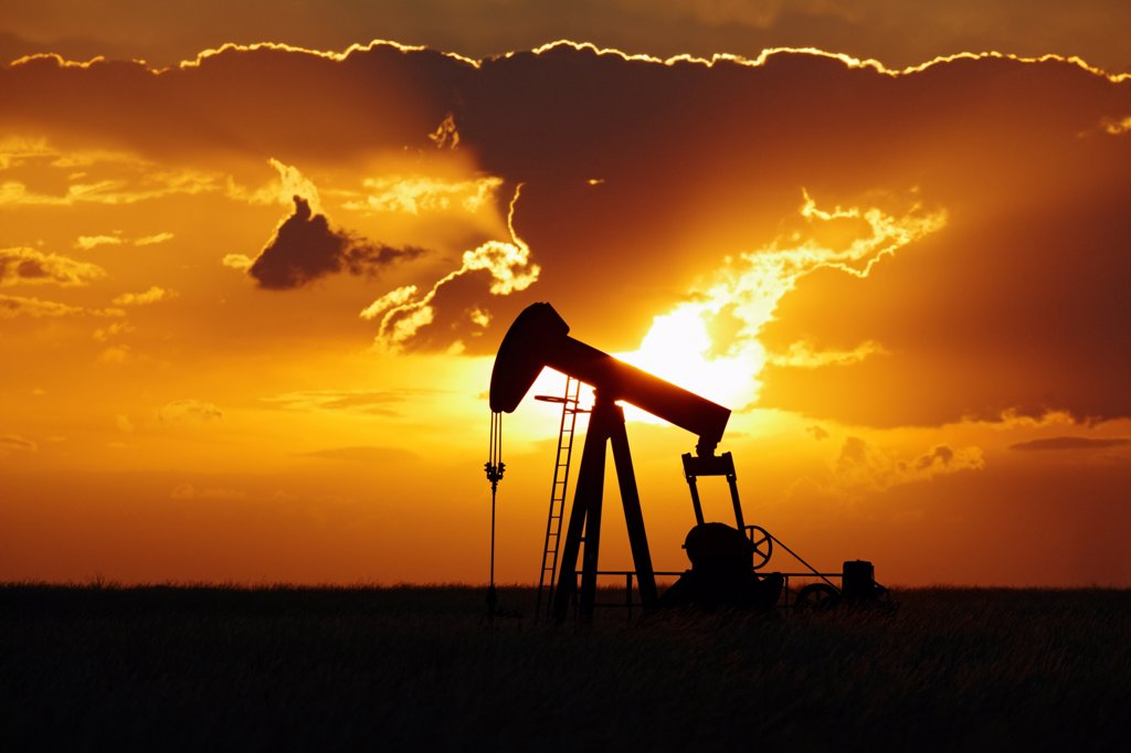 Stock Photo: 4316-4068 Oil Well Pump Jack at Sunset