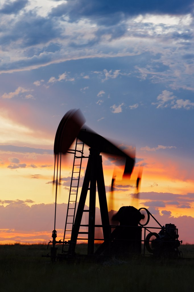 Oil Well Pump Jack at Sunset, Blurred Motion : Stock Photo