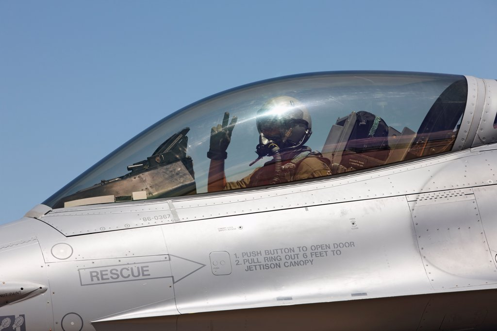 Stock Photo: 4316-4189 Pilot of an F-16 Makes Peace Sign Gesture