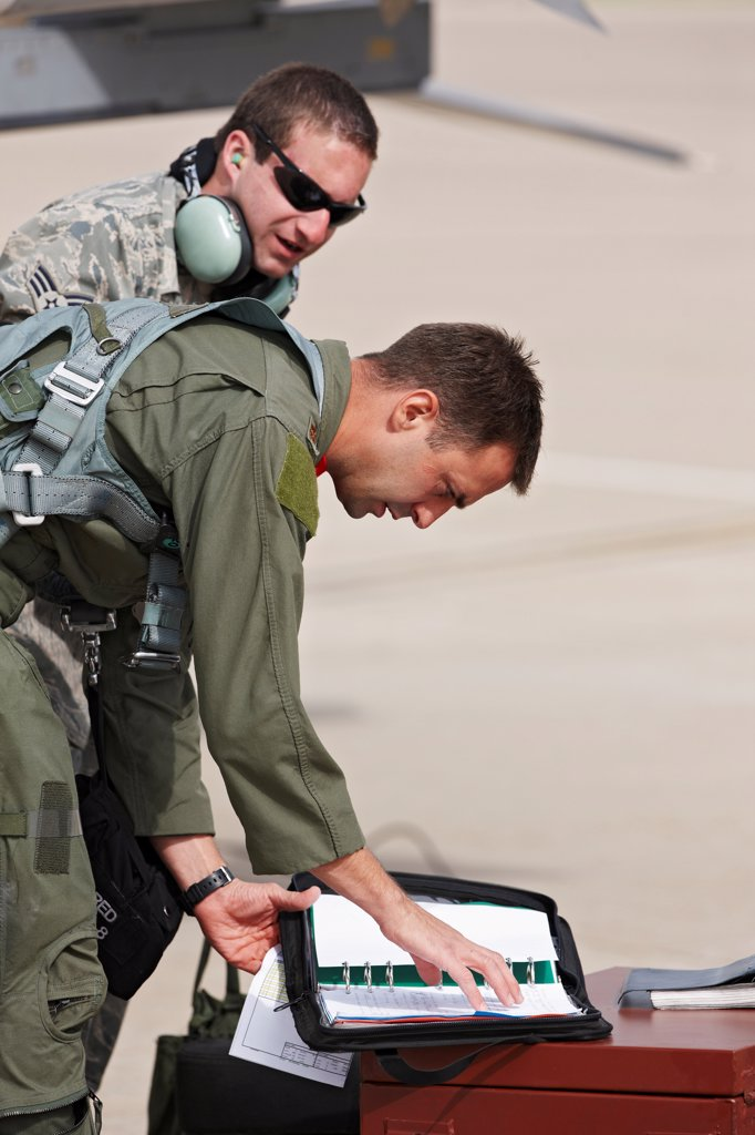 F-16 Pilot Does a Pre-Flight Check : Stock Photo
