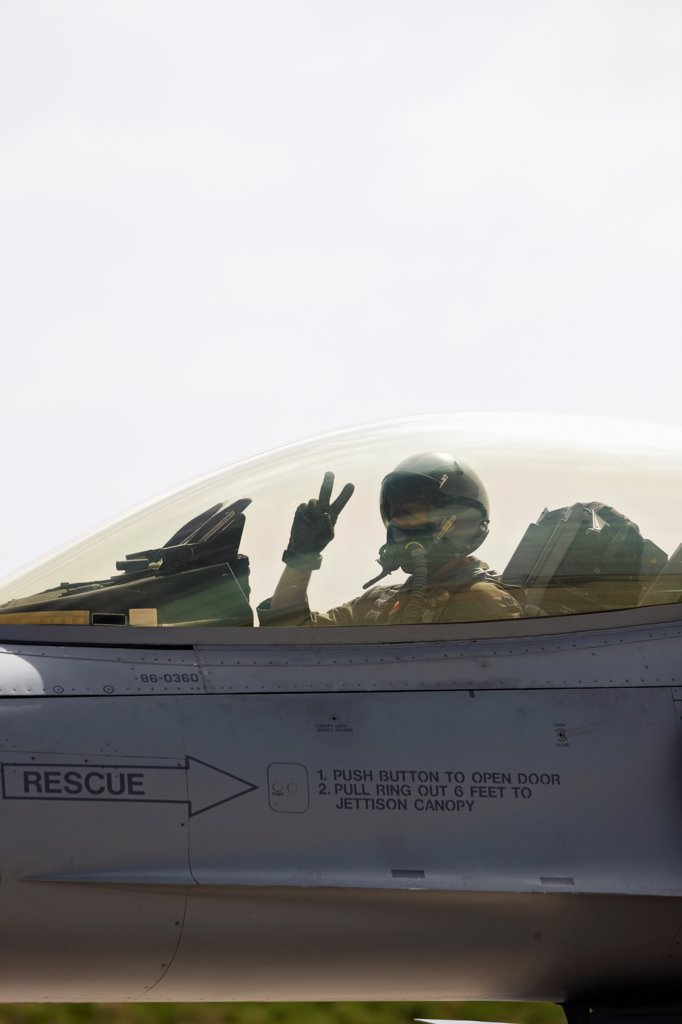 Stock Photo: 4316-4216 Pilot Makes a Peace Gesture Before Launching F-16