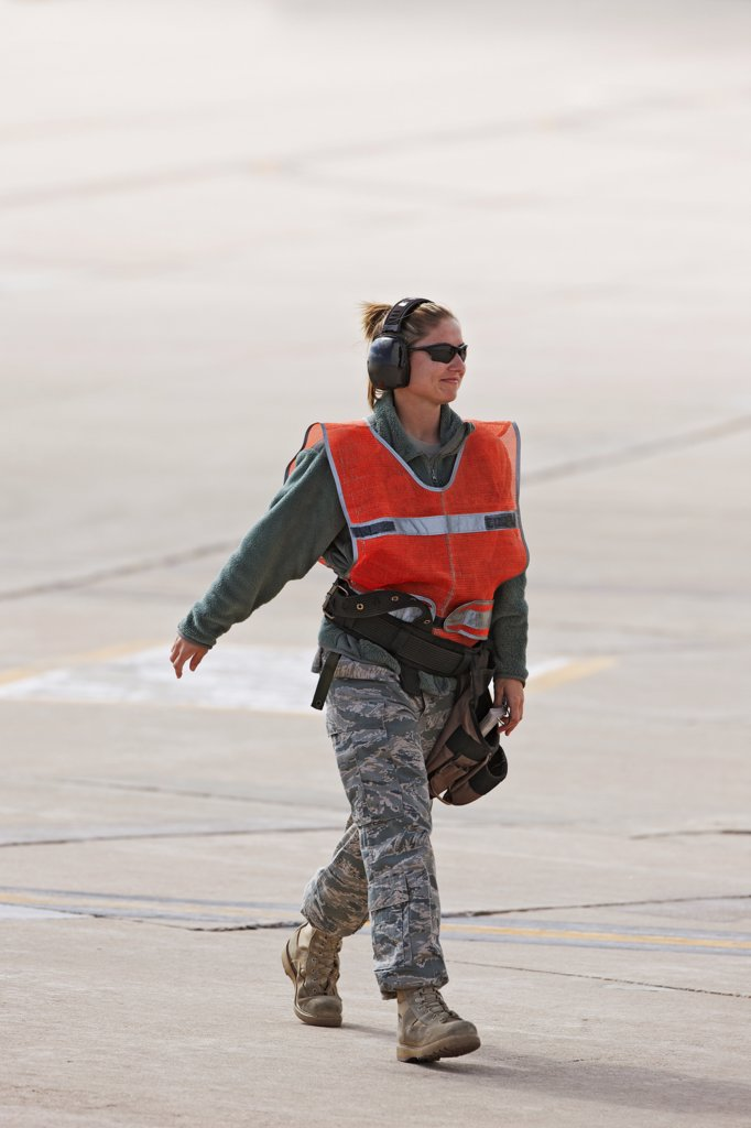 Ground Crew Member on Flight Line During Launch of F-16s : Stock Photo