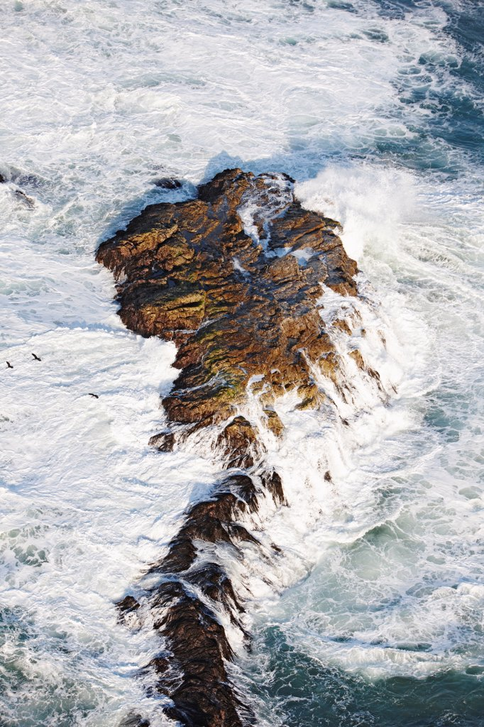 Stock Photo: 4316-4354 Aerial View of Waves Breaking on Rocks