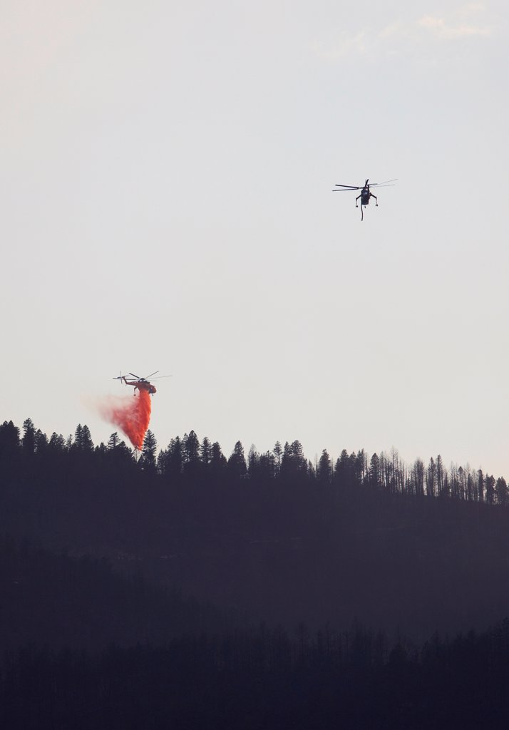 Stock Photo: 4316-4468 Large firefighting helicopters dump fire retardant on raging wildfire, Colorado, USA