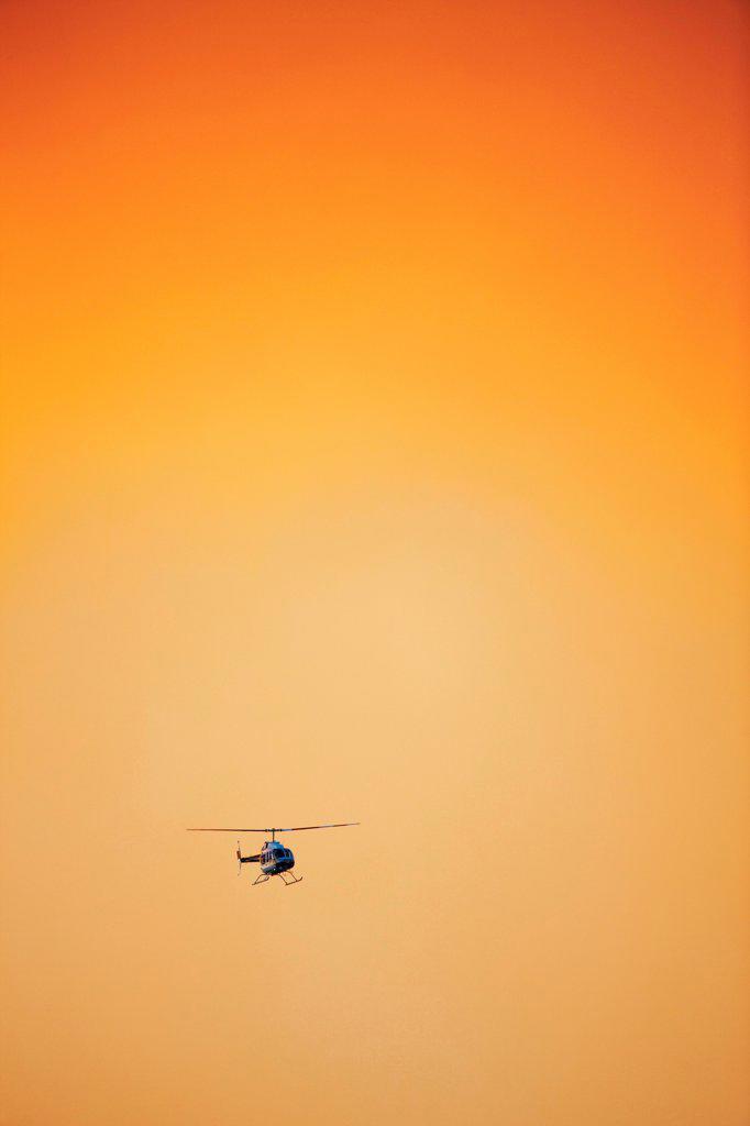 Stock Photo: 4316-4526 Helicopter flies through dense smoke from raging mountain wildfire, Colorado, USA