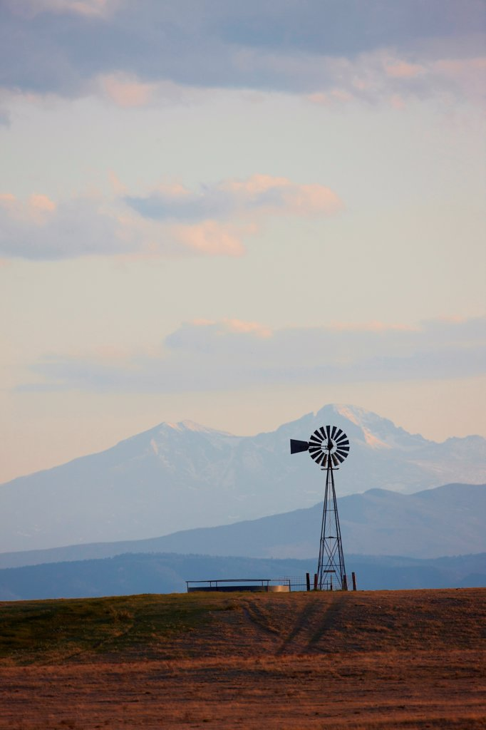 Stock Photo: 4316-4542 Lone Windmill, distant Longs Peak (14,259 feet, 4,346 meters), Colorado, USA