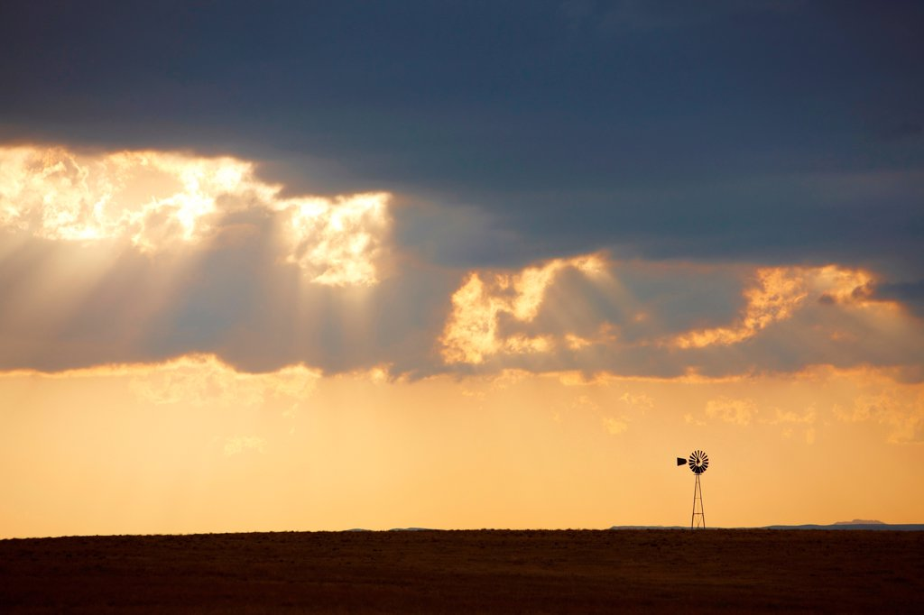 Thunderstorm, crepuscular rays, and lone windmill, Colorado, USA : Stock Photo